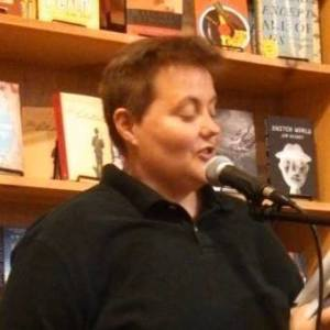 KELLI WITH BLACK POLO KINDA CUTE AT BLUESTOCKINGS READINGS