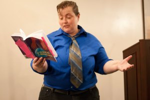 kelli reads from book at funeral home