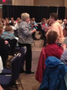 with crowd at nursing conference